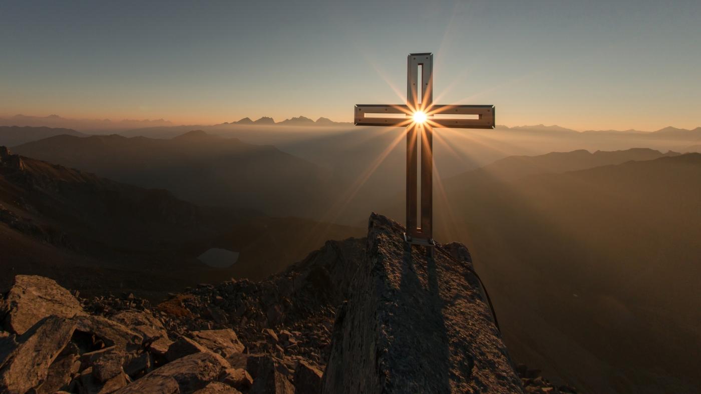 cross with sun at sunrise