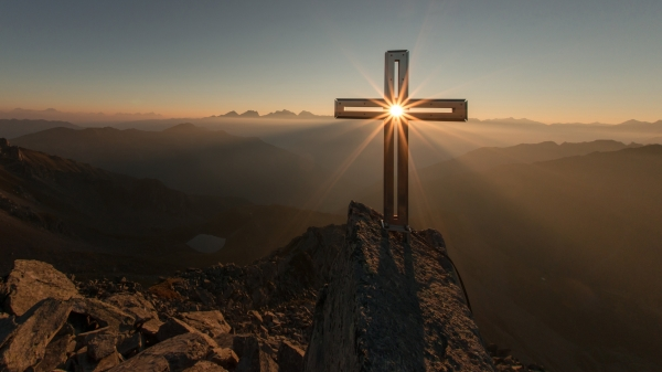 cross with sun at sunrise