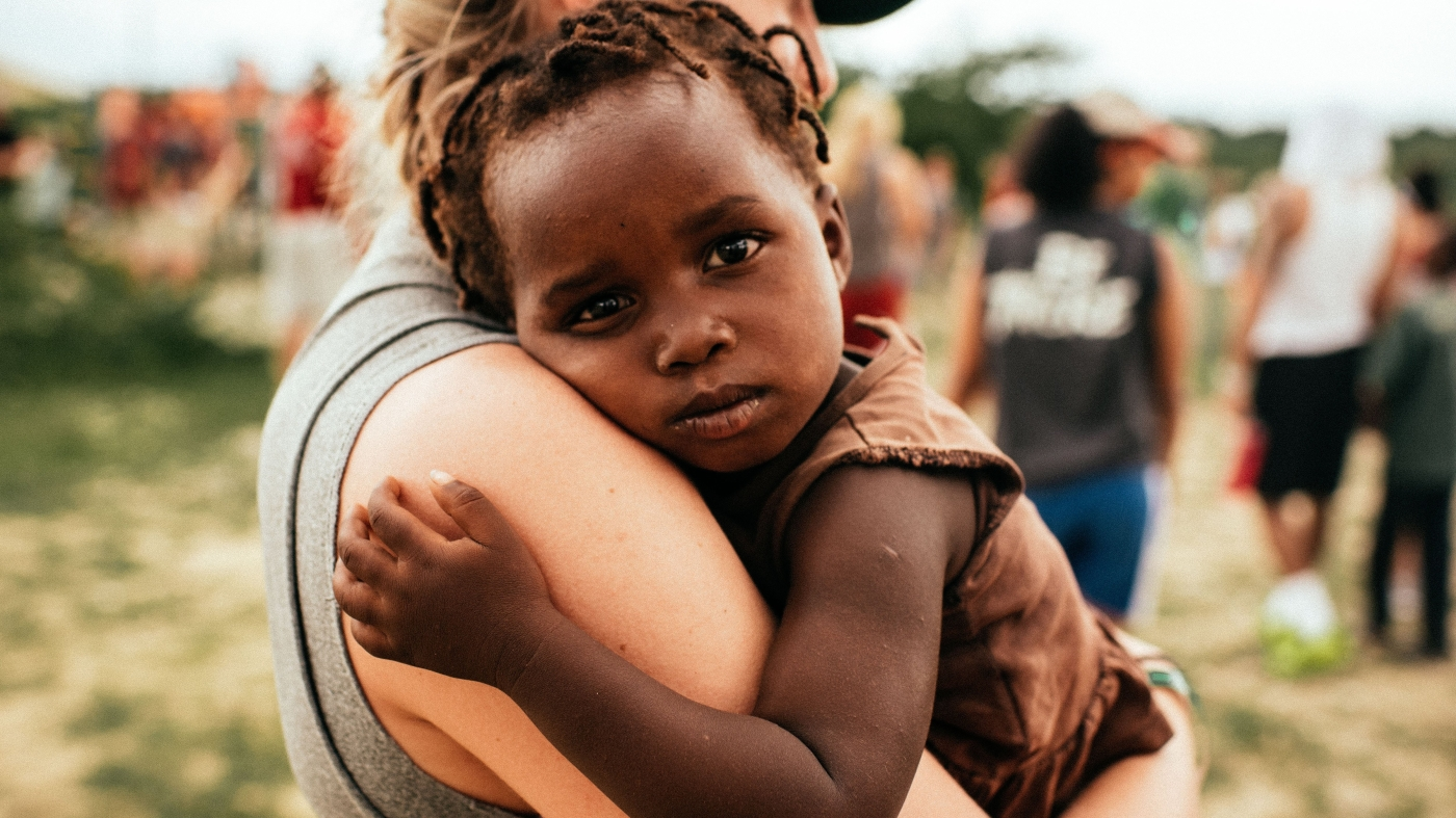 child in arms of young woman